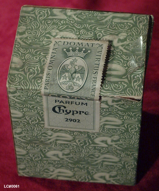 Detail of Outer packaging for Coty's Chypre perfume showing detail of the crest awarded to a Coty ancestor by the Emperor Napoleon Bonaparte