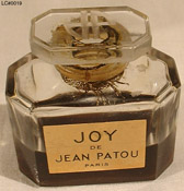Photo of Joy bottle showing JP logo on glass stopper