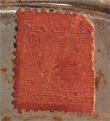 Photo of unknown stamp affixed to bottle of 'Trefle Incarnat' by L.T. Piver